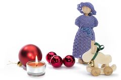 Кукла рождества вычисляет с свечой и красными шариками Стоковое Фото