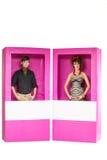 Куклы мальчика и девушки в коробке Стоковые Изображения