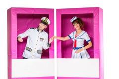 Куклы мальчика и девушки в коробке Стоковое Изображение RF