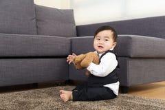 Кукла игры ребёнка Азии Стоковые Фото