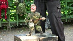 Кукла марионетка на строках 4K сток-видео