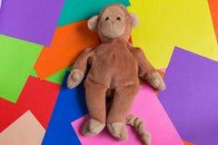 Кукла обезьяны на красочной предпосылке Стоковые Изображения RF