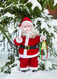 Кукла Санта Клауса под деревом Стоковое фото RF