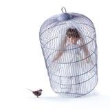 Кукл-невеста в клетке и маленькой птице Стоковая Фотография