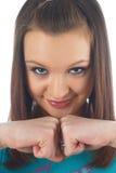 кулачки показывая женщину стоковое фото