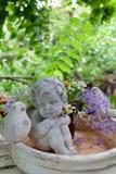 Купидон и цветки Стоковое Изображение RF