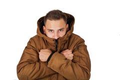 Куртка parka зимы молодого человека нося стоковые фото