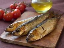 Курят рыбы стоковые фото