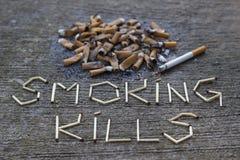 Куря убийства стоковые изображения