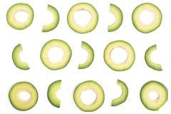 Куски авокадоа изолированные на белой предпосылке Взгляд сверху Плоская картина положения Стоковое Изображение RF