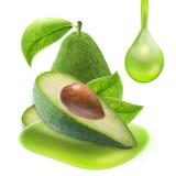 Куски авокадоа и масло падения изолированное с путем клиппирования Стоковое Изображение