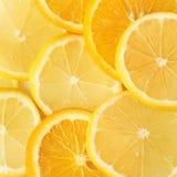 куски апельсина и лимона изолированных на белой предпосылке Стоковые Фото