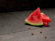 Куски арбуза на черной предпосылке Стоковое фото RF