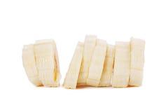 Куски банана на белой предпосылке Стоковые Изображения