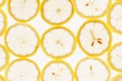 Куски лимона на белой предпосылке Стоковые Фотографии RF