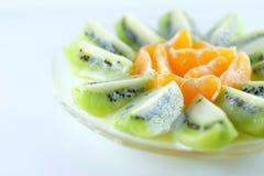 Куски кивиа и апельсинов Стоковое фото RF