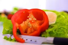 Куски красного перца на белой предпосылке Стоковые Изображения RF