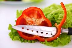 Куски красного перца на белой предпосылке Стоковое Фото