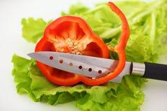 Куски красного перца на белой предпосылке Стоковые Фотографии RF
