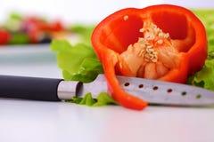 Куски красного перца на белой предпосылке Стоковая Фотография RF
