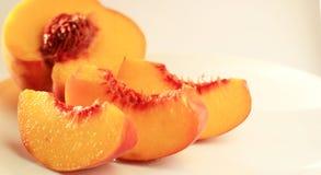 Куски персика Стоковые Изображения