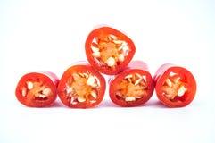 Куски перца красных чилей на белой предпосылке Стоковая Фотография