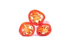 Куски перца красных чилей на белой предпосылке Стоковые Фото