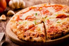 Куски пиццы Peperoni Стоковая Фотография