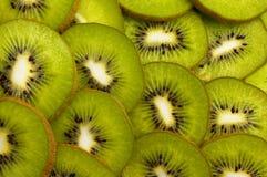 Куски плодоовощ кивиа как предпосылка Стоковые Изображения RF