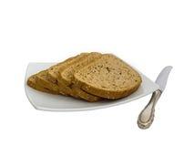 Куски хлеба и ножа Стоковая Фотография