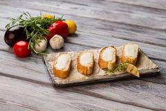 Куски хлеба с маслом Стоковые Фото