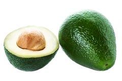 Кусок авокадоа и весь зрелый зеленый плодоовощ авокадоа изолированные на a Стоковые Изображения RF