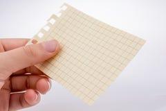 Кусок бумаги в руке Стоковые Фото