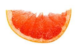 Кусок грейпфрута изолированный на белизне Стоковые Фото