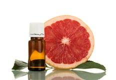 Кусок грейпфрута и ароматичной жидкости для курить Стоковое Фото