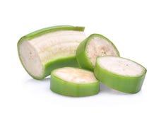 Кусок зеленого сырцового банана изолированного на белизне Стоковые Фото