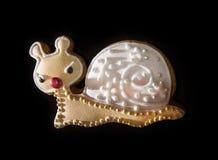 Кусок металла на темной предпосылке, тема пряника рождества стоковые изображения