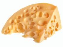 Кусок очень вкусного желтого сыра с круглыми отверстиями Стоковая Фотография