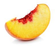 Кусок персика изолированный на белизне Стоковое фото RF