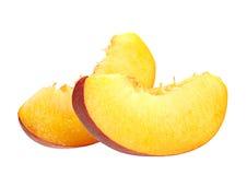 Кусок персика на белизне Стоковая Фотография
