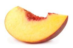 Кусок плодоовощ персика на белизне Стоковая Фотография