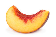 Кусок плодоовощ персика на белизне Стоковые Фото