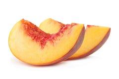 Кусок плодоовощ персика на белизне Стоковые Изображения