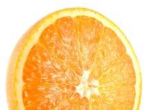 Кусок половинного зрелого апельсина изолированного на белизне Стоковая Фотография
