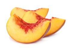 Кусок плодоовощ персика на белизне Стоковые Изображения RF