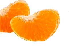 Кусок цитрусовых фруктов апельсина мандарина на белизне Стоковые Фотографии RF