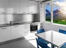 Кухня с белыми мебелью и окнами с пейзажем горы стоковые фотографии rf
