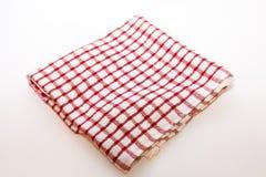 Кухня сложила полотенце в клетке на белизне Стоковое фото RF