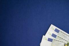 Куча банкнот евро на голубой предпосылке Стоковое фото RF