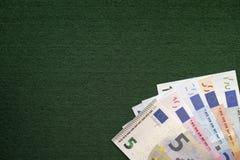 Куча банкнот евро на зеленой предпосылке Стоковое фото RF